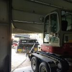 delaware-backhoe-garage-door-accident
